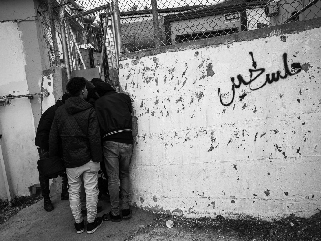 Refugee outside a side entrance of Moria camp.